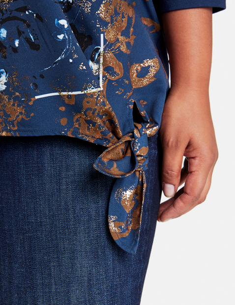 Blouse top with a knotted detail