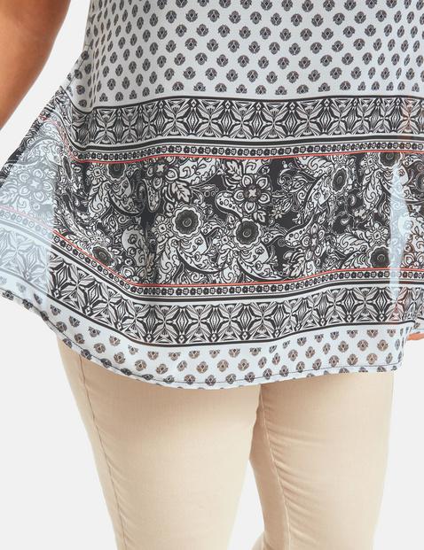 Bluzkowy top z długimi rozcięciami po bokach