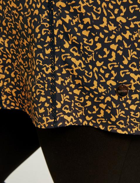 3/4-sleeve top with an animal print