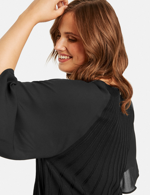 Flared jumper with chiffon sleeves