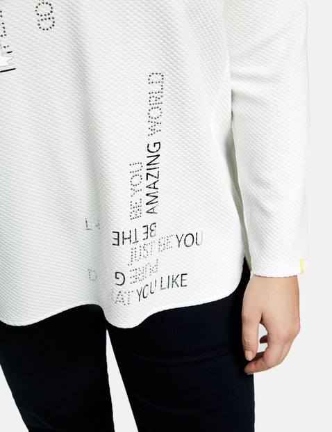 Long sleeve top with lettering and decorative stones