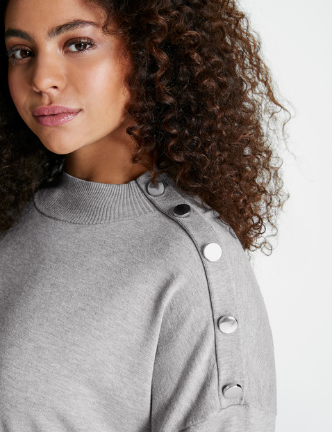 Jumper with a stand-up collar and a decorative button placket
