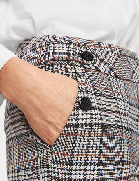 Wide trousers with a check pattern