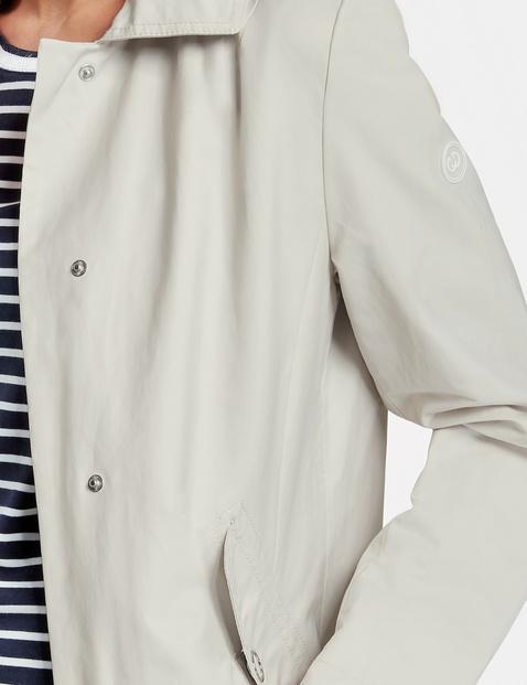 Korte mantel met stolpplooi