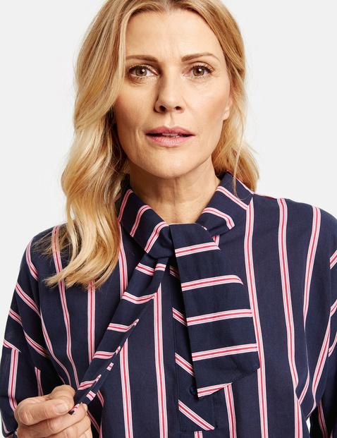 Oversized blouse met strik