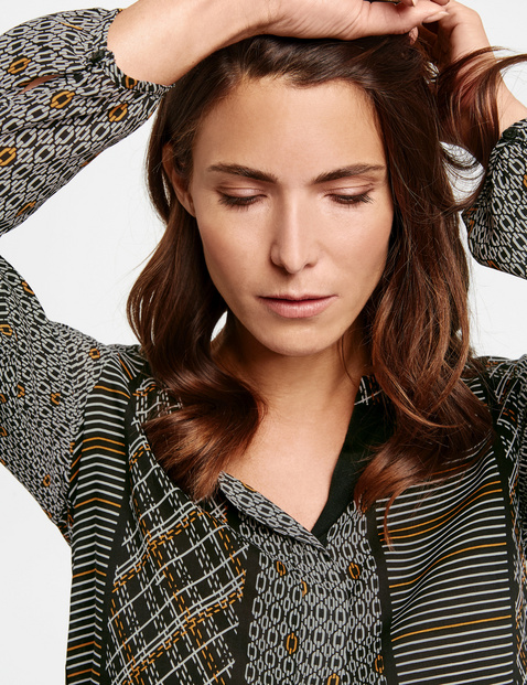 Long sleeve blouse with a patchwork pattern