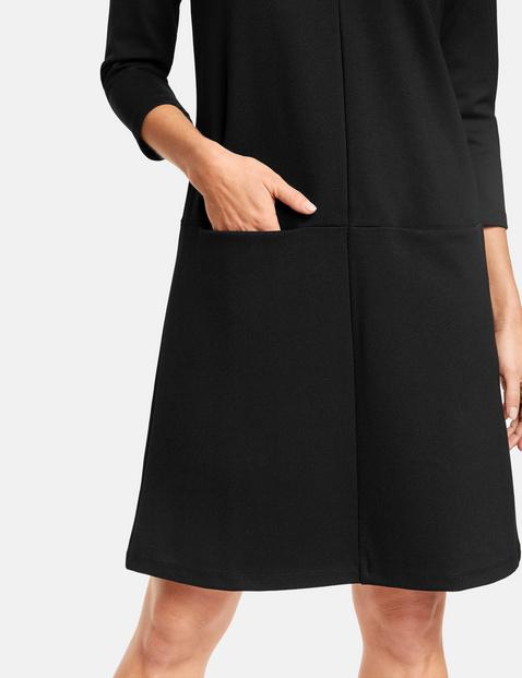 Ausgestelltes Jerseykleid