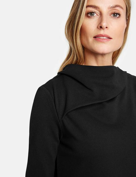 Dress with a draped neckline