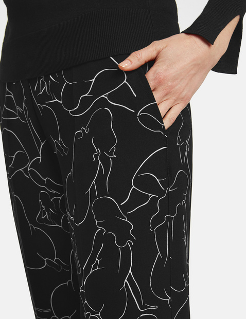 Wide trousers with an art print