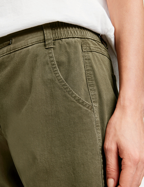 Tracksuit bottoms with wide elasticated leg openings