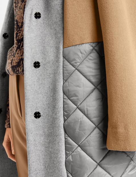 Mantel mit Materialpatch