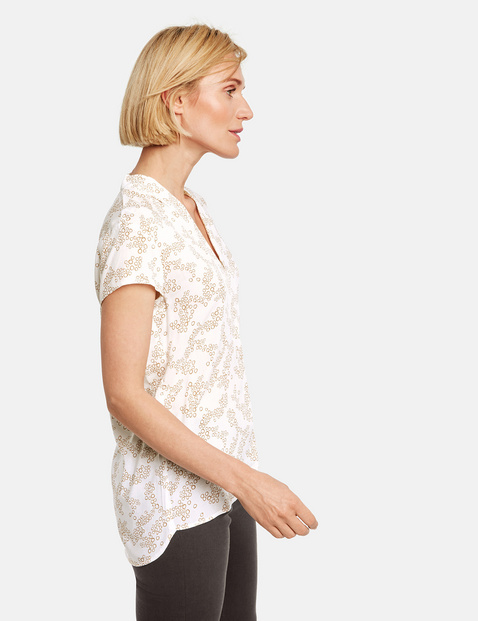 Short sleeve blouse with a minimalist pattern