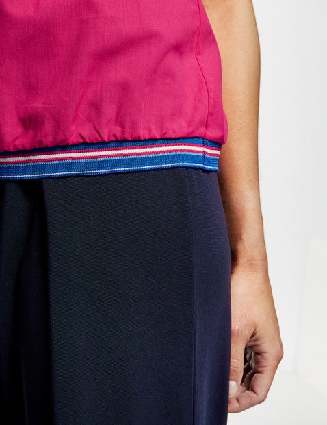 Sleeveless blouse with a jersey waistband
