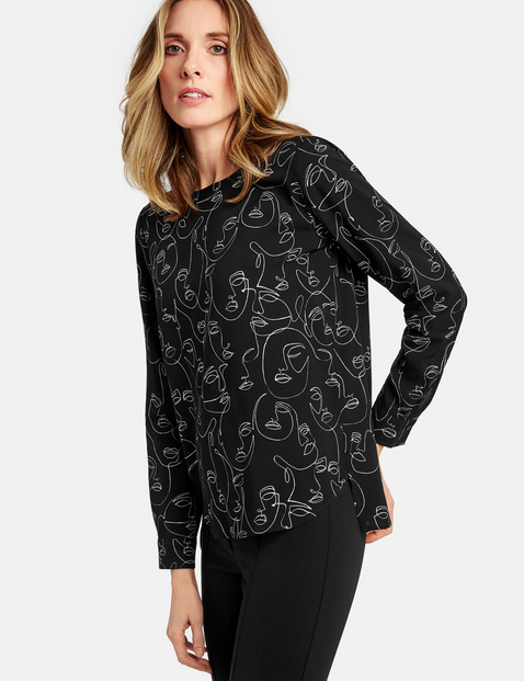 Long sleeve blouse with a face print