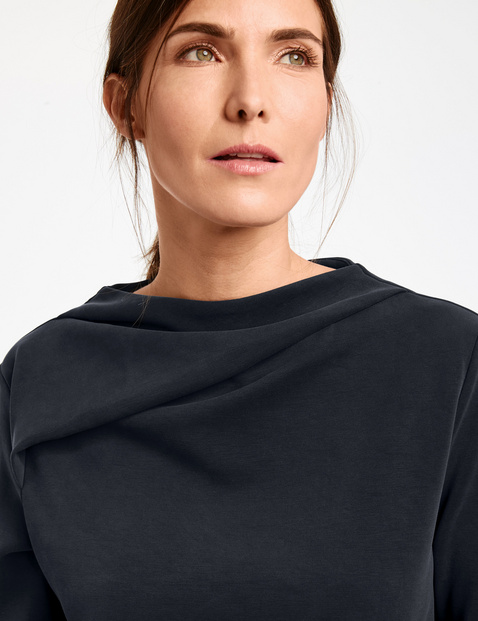 Long sleeve top with a draped cup collar