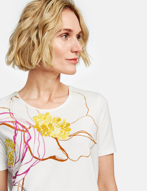 1/2-sleeve top with a large flower