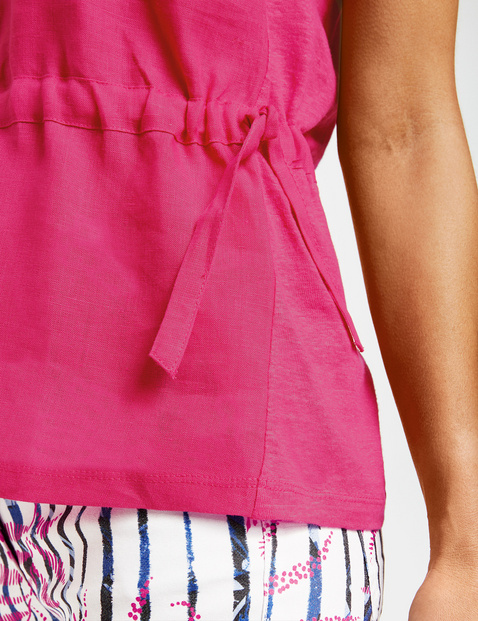 Top with a drawstring waist