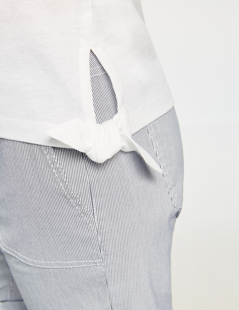 Top with a percentage of linen