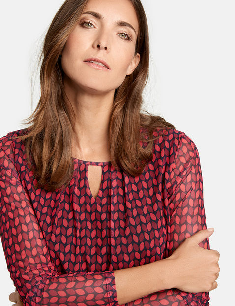 Long sleeve top with an all-over pattern