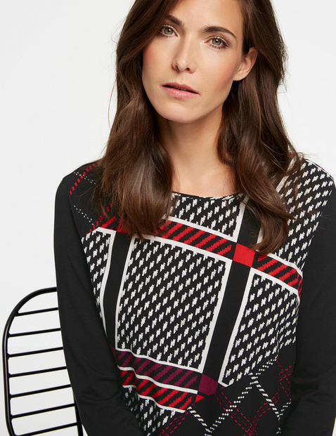 Long sleeve top with a panelled check pattern