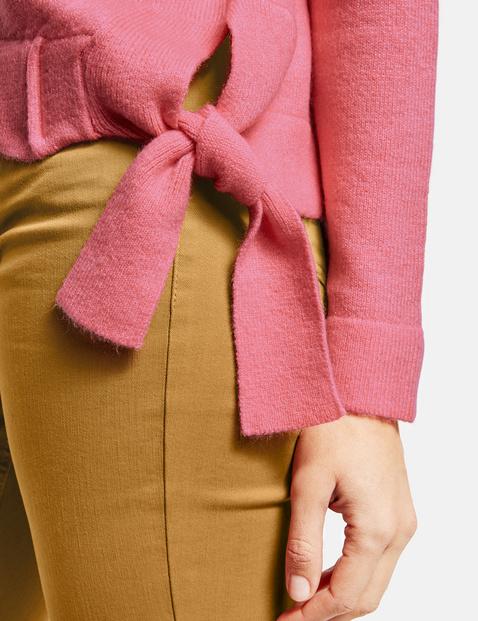 Sweter z marszczonymi tasiemkami