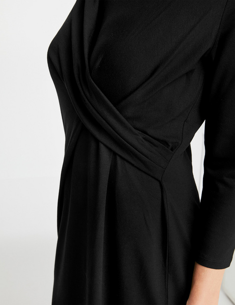 Dress with a wrap-over effect
