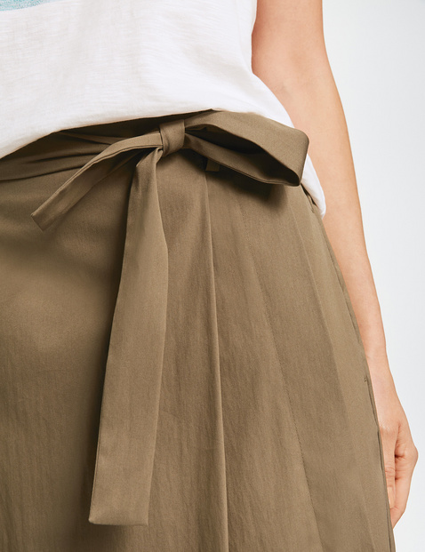 Skirt with a mock wrap-over effect