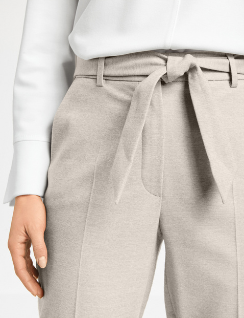 Trousers with a fabric belt