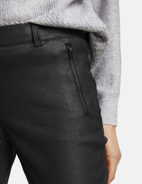 Powlekane spodnie Slim Fit