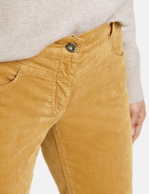Slim fit trousers with a velvety texture