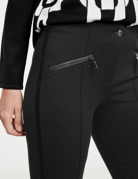 Slim fit trousers with zip pockets