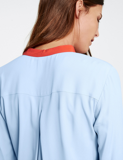Long sleeve blouse with contrasting edges