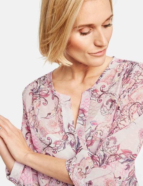 Blouse with integrated top