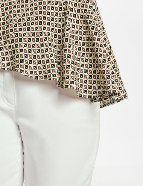 Blouse top with an asymmetric hem