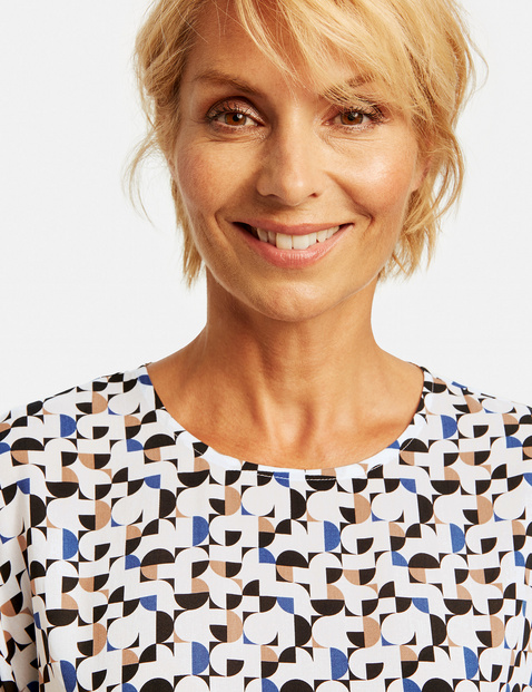Blouse top with geometric polka dots
