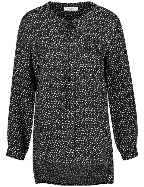 Long blouse with a swirling pattern