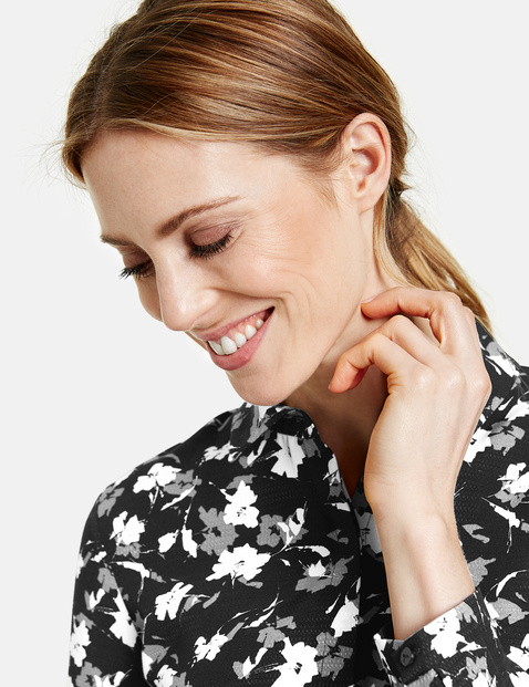 Long sleeve blouse with a floral pattern