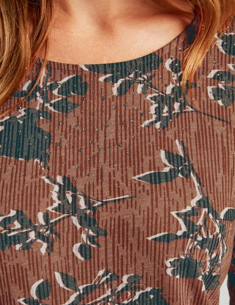 Long sleeve top with decorative rhinestones
