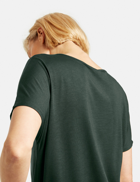 Top with 1/2-length sleeves and a wrap-over effect
