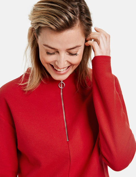 Long sleeve top with a turn-up collar