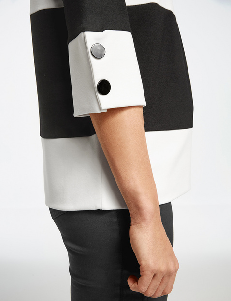 3/4-length sleeve top with a black and white panel