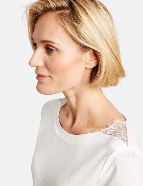 Top with a lace trim and 1/2-length sleeves