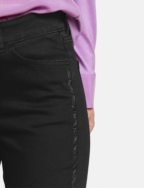 Jeans met glinsterende streep
