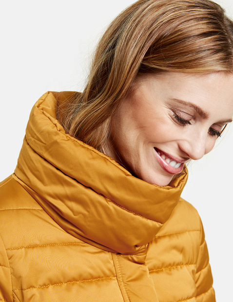 Quilted jacket with a protective stand-up collar