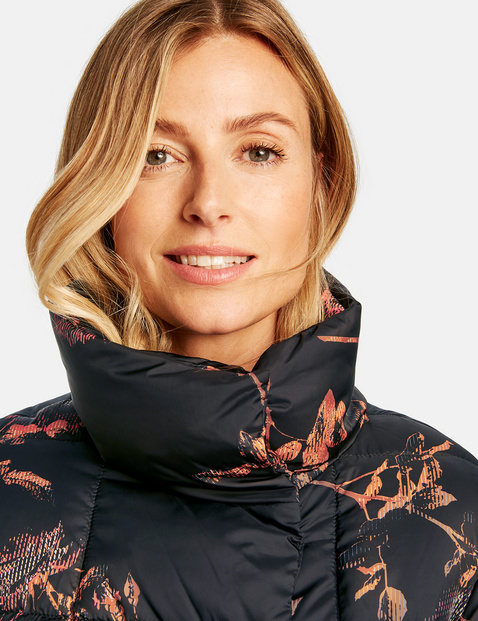 Quilted coat with a floral pattern