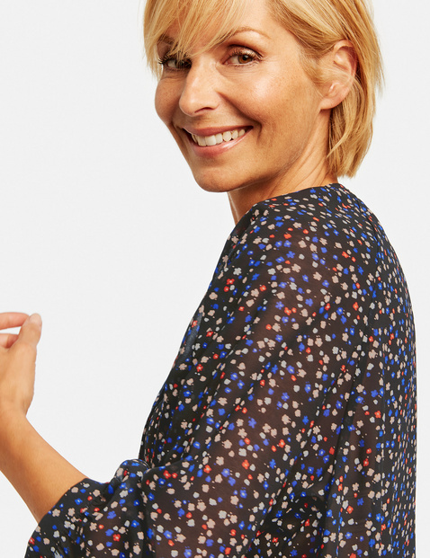 Tunic with a mille-fleurs print
