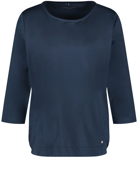 3/4-sleeve top with a subtle sheen