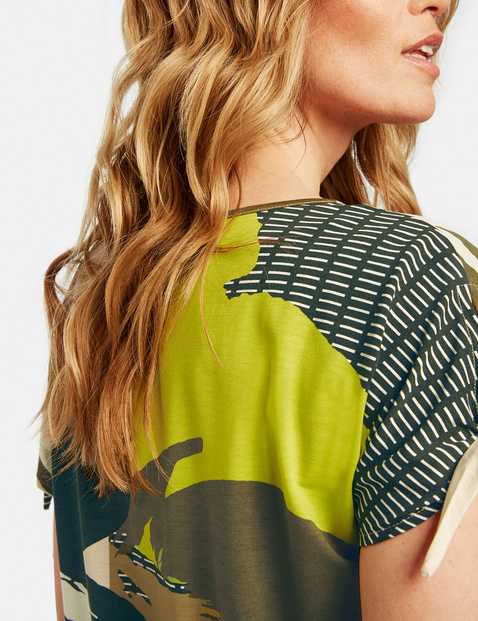 Top with a patchwork pattern