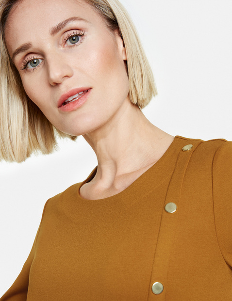 Long sleeve top with decorative buttons