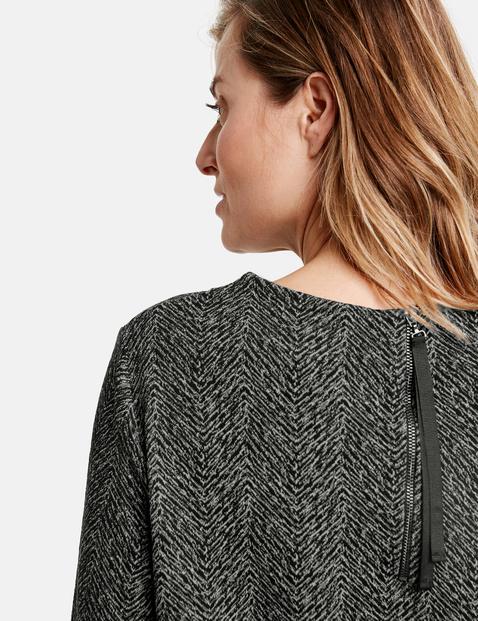 3/4-sleeve top with a herringbone pattern